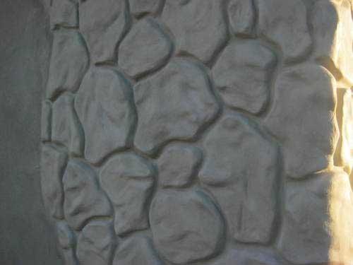 Фото: Имитацией камня при помощи штукатурки