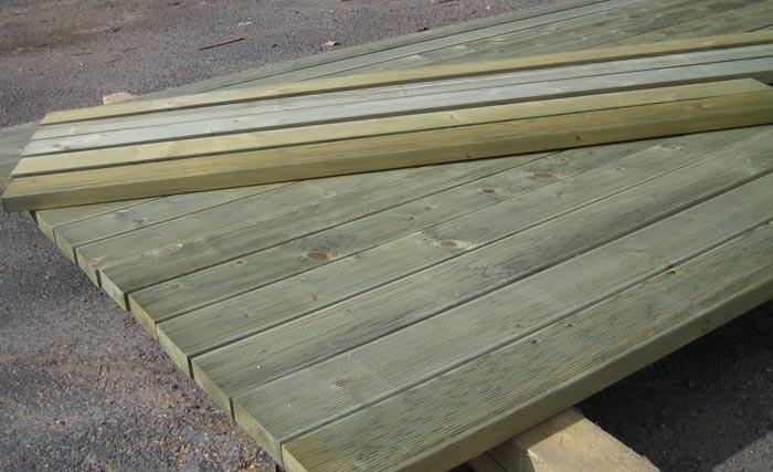Фото: Термообработанной древесина в виде напольного материала