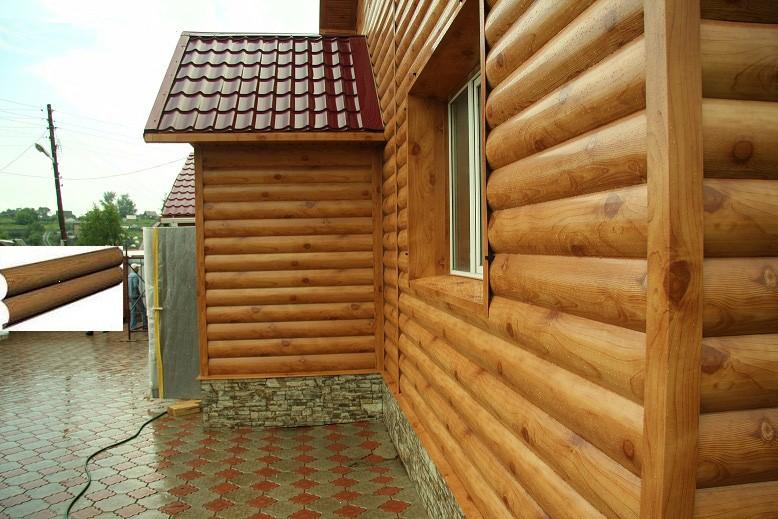 Фото: Металлосайдинг хороо подходит для имитации деревянной поверхности